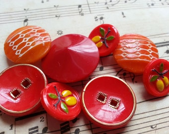 Red and Orange Lovely Vintage Glass Buttons. Lot of Eight.