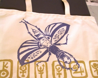Pretty Insect shoulder bag screen printed lavender and gold on white recycled fabric made in USA eco friendly shopping bag dragon fly beetle
