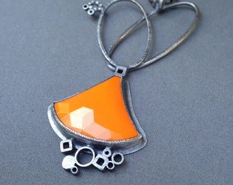 Bright orange sterling silver charm necklace pendants vintage glass metalsmith contemporary modern jewelry statement necklace eclectic