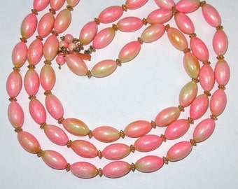 SJK VINTAGE -- Hong Kong Signed Fuzzy Peach Colored Plastic Beaded Three Stranded Necklace (1950's-60's)