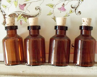 Amber Glass Bottles / Four Items / Cork Closures
