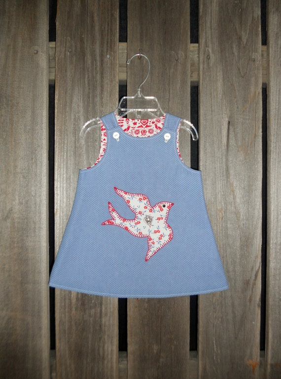 Baby dress in 3 to 6 months size (red, white, blue peace dove)