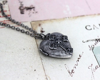cross. locket necklace. silver ox with etched lines heart