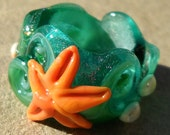 """Lampwork Dread Bead  1/2"""" Large Hole  Beach theme with waves starfish barnacles and dichroic glass in teal, coral, emerald green, and ivor y"""