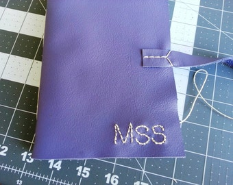 Hand-embroidered Monogram on leather book cover