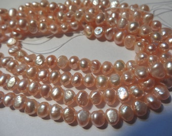 16 inch Strand Natural Peach Freshwater Pearls Pillow Side Drilled 23