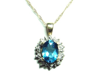 SALE 10k gold Blue topaz and diamond pendant with chain