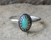Little ornate sterling ring with oval Welo opal cabochon