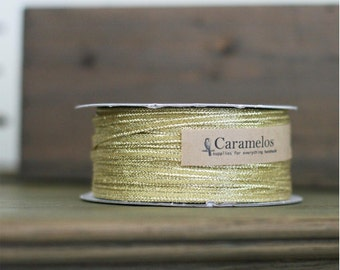Bulk 100 yard roll of Narrow Metallic Gold Ribbon 1/8""