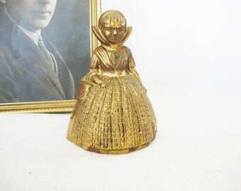 vintage brass bell england lady
