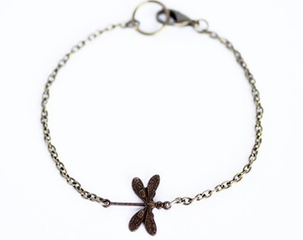 Delicate minimal dragonfly charm bracelet on antique bronze curb chain // Inspired by Coheed and Cambria