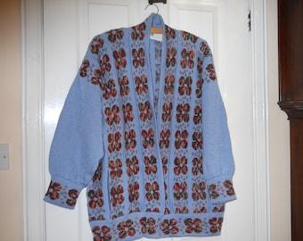 half price Ladies sweeter/ jacket . Knitted in pale blue with multi coloured poppies/ Ladies half price jumper. Half price  sweater