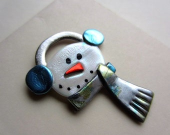 Snowman with blue earmuffs pin brooch
