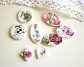 A Set of 8 Handmade Ceramic Itty Bitty Buttons