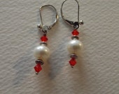 E 552  Pearl earrings with siam crystals and sterling saucers.