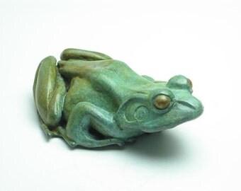 Basking frog bottle opener: Bronze frog sculpture. Vert de gris patina.
