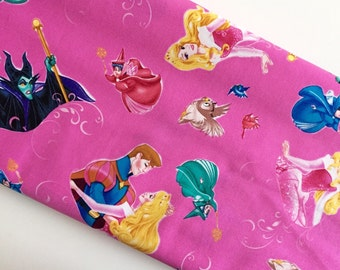Disney Sleeping Beauty Film Toss Dark Pink cotton woven by the yard