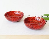Pair of two small resin salt and pepper spice pinch trinket dish bowls in ruby red glitter sparkle.