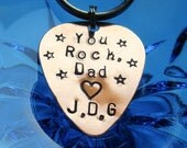 You Rock Dad withinitials and stars and a heart hand stamped guitar pick key chain