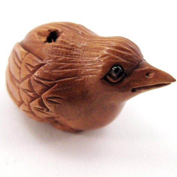 Crouching bird bead hand carved boxwood ojime from