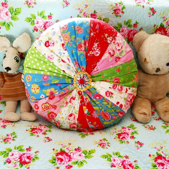 Colourful handmade patchwork round cushion
