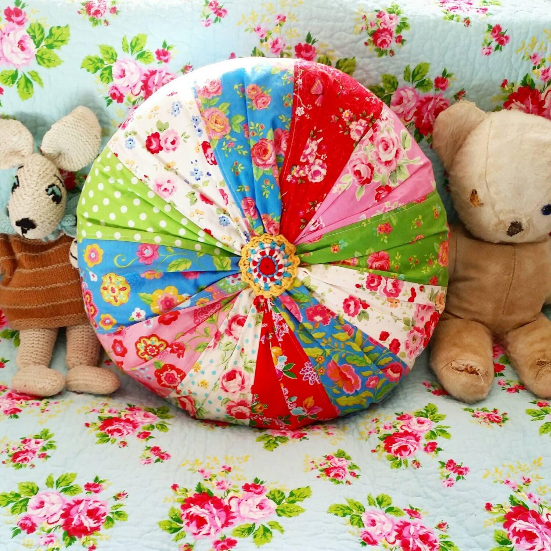 Colourful handmade patchwork round cushion