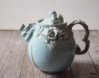 Alice in Wonderland Teapot -  Stoneware teapot with roses in light blue granitic glaze