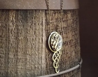 Steampunk Necklace Clockworks Brass Watch Movement Swirls and Scrolls Recycled Vintage Watch