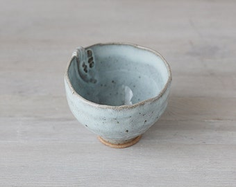 Hand built stoneware cup or deep bowl with pretty blue glaze