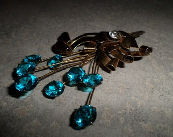 huge gorgeous sterling silver gold plated floral spray Brooch prong set vibrant blue crystals