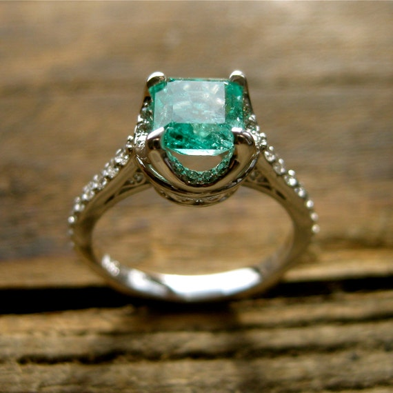 emerald engagement ring in 14k white gold with