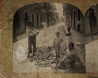 "Old stereoscope slide ""Children Gathering Firewood"" in Panama"