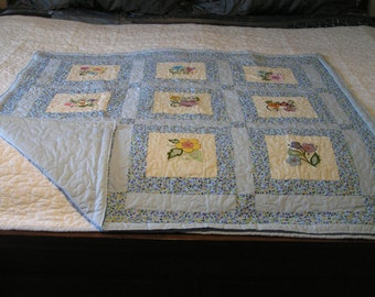 Handmade   baby or lap quilt with embroidered jacobean designs