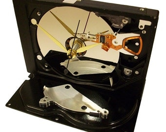 FREE SHIPPING USA! This Gadget is a Computer Hard Drive Clock Accented with Disk Platter Spacer.