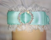 Plus Size garter in Aqua Satin with gorgeous rhinestone buckle adorning the bow. White Lace adds a feminine touch