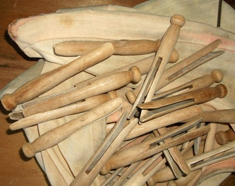 60 Authentic Time Worn Wooden Clothespins in an old hanging bag