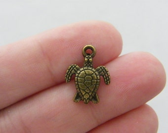 8 Turtle charms antique bronze tone BC25
