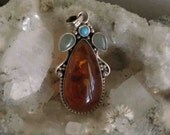 Sterling Silver Baltic Amber Pendant with Green Jade and Turquoise Stones