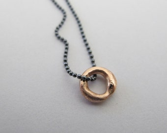 Solid 14k rose gold pendant on oxidized silver chain
