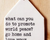 porcelain wall tag screenprinted text what can you do to promote world peace?  go home and love your family. -mother teresa
