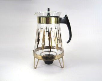 Atomic era glass coffee tea warming carafe with gold details, black plastic handle and tea light holder