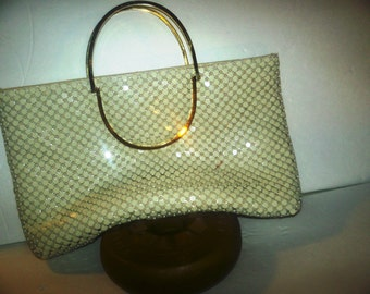 Vintage gold mesh hand bag with handles in mint condition silk lining.