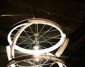 White Lightning Bike Rim Chandelier.. Amarillo Tattoo Removal Clinic