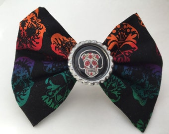 Colorful skull fabric hair bow with headphone skull bottlecap center