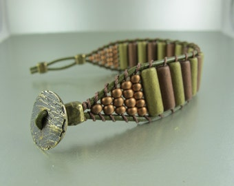 Handwoven Ladder Bracelet, Metallic Ceramic Beads, Gold and Copper Tubes, Seed Beads, Olive Greek Leather Cord, 3/4 inches wide