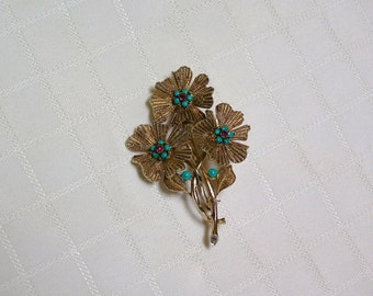 Vintage Capri Flower bouquet..gold tone petals turquoise and rhinestone center brooch