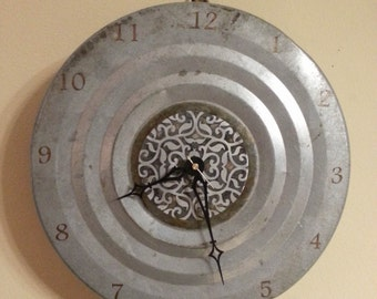 "Recycled etched metal statement clock with filigree pattern 16"" wide"