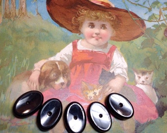 Five Antique Black Glass Oval Whistle Buttons