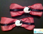 Red, white, and black hair bows with sheep. Portion of sale goes to charity.