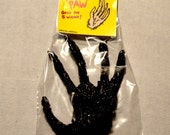 monkey's paw dime store toy horror taxidermy luck charm